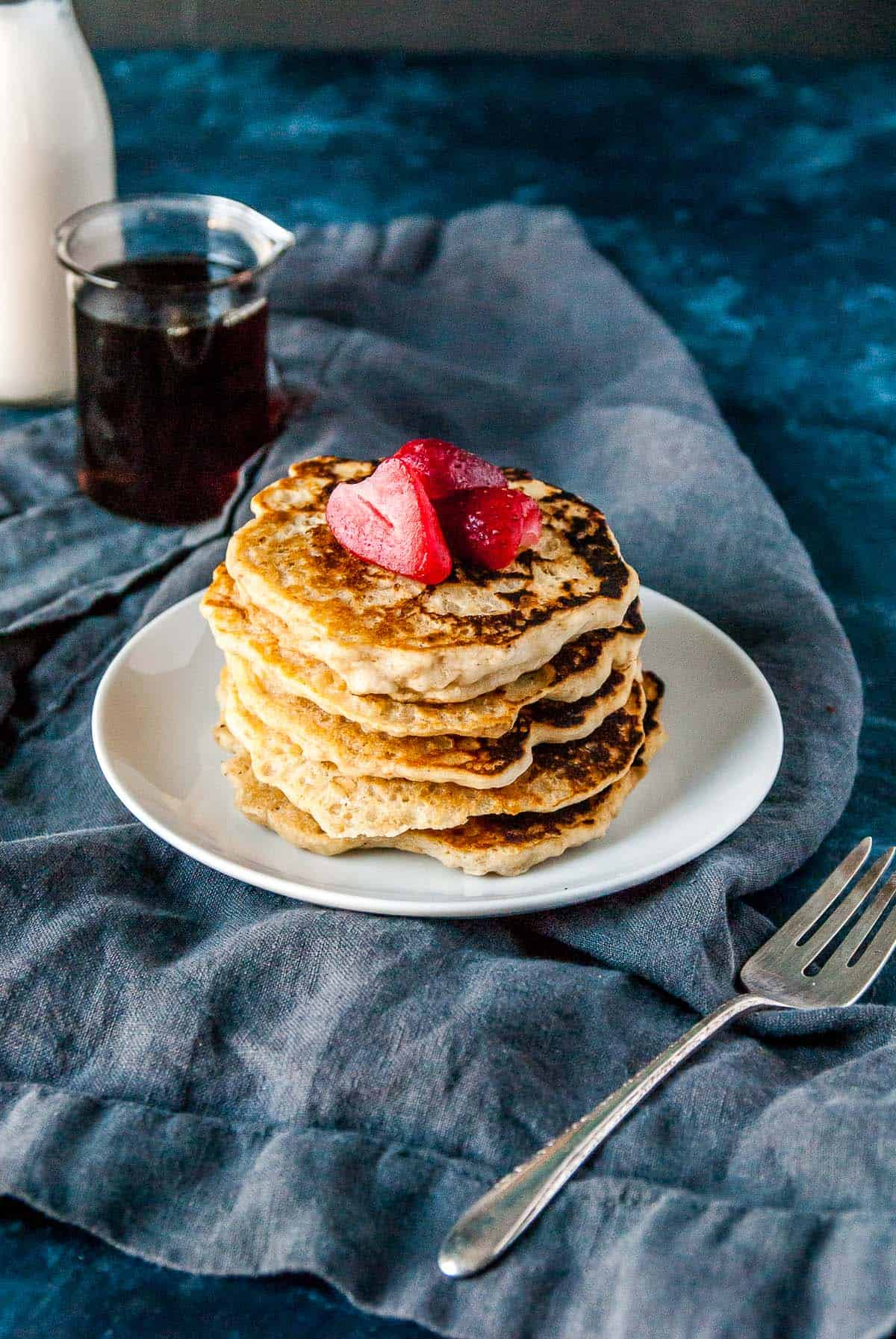 gluten free pancakes stacked on a plate