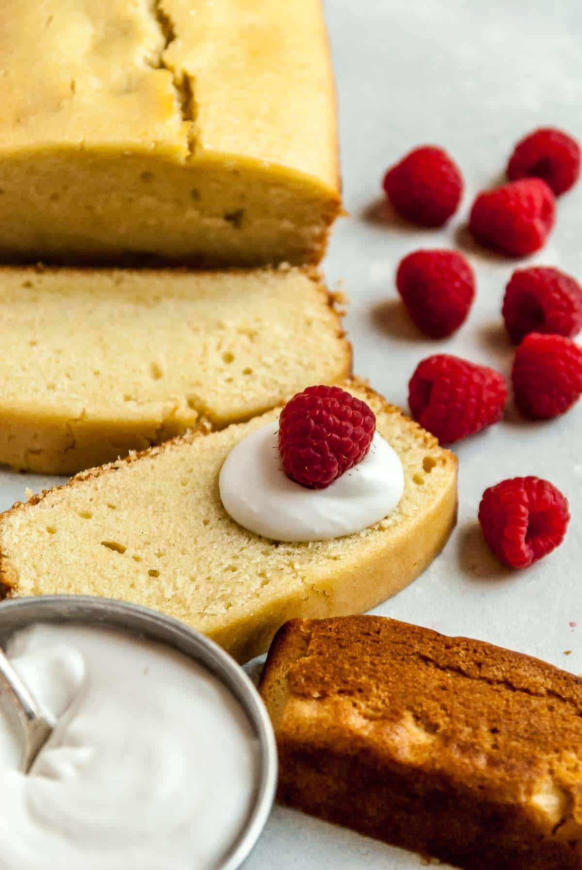 slices of vegan pound cake and raspberries