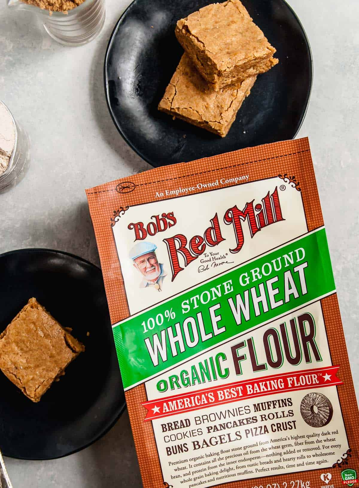 Whole Wheat Vegan Blondies on plate with bag of flour