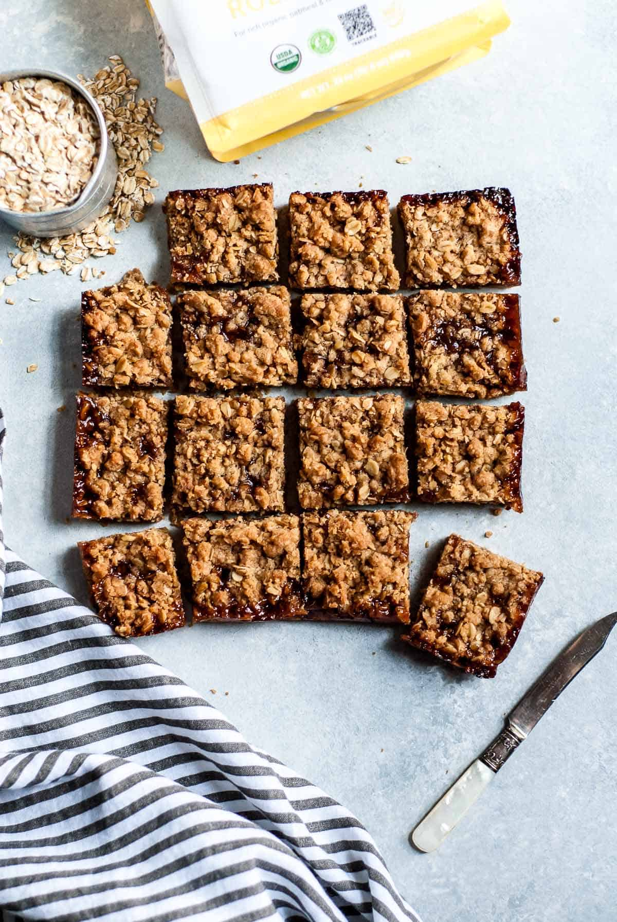 cherry crumble bars on board with oats