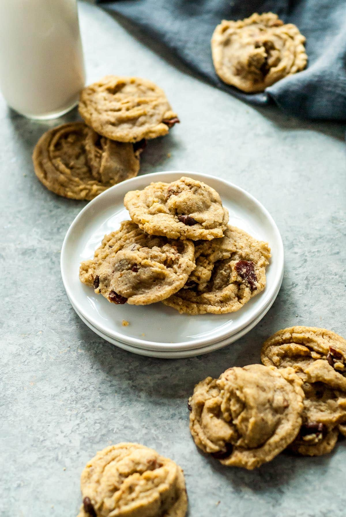cookies on a plate with glass of milk