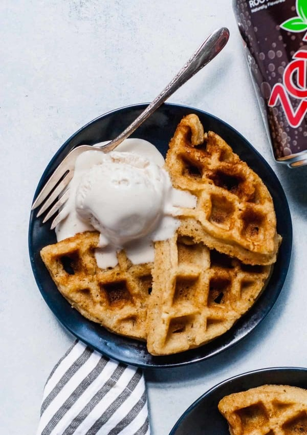 Waffle on plate with melting ice cream scoop and zevia can