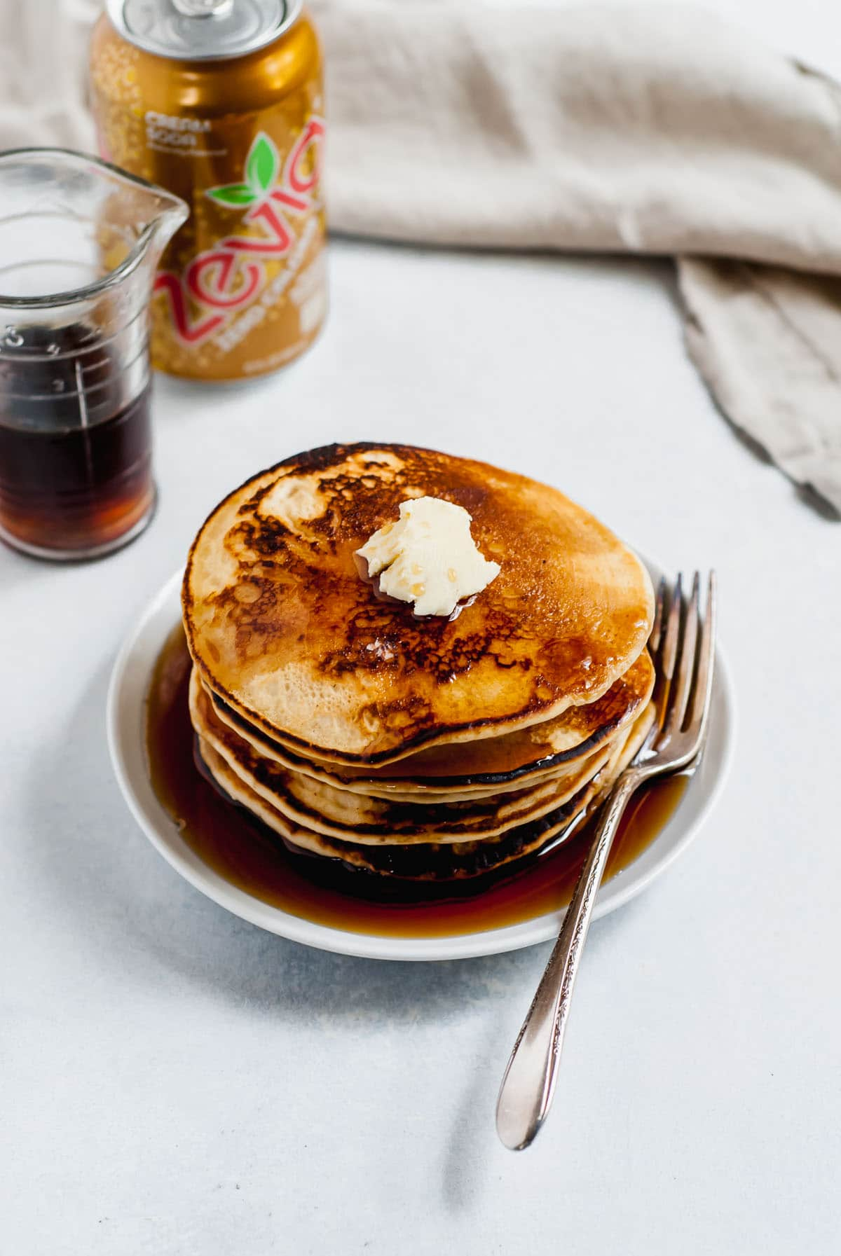 Pancakes on a plate with butter and syrup