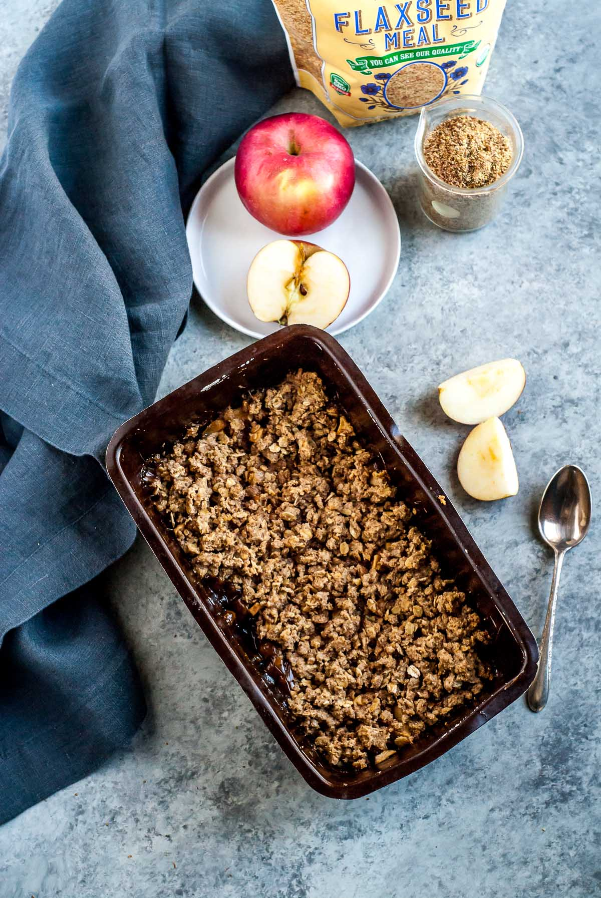pan of apple crisp with apples