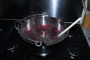 Large pan of gently simmering jam