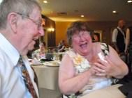 John with Cleora reacting to magic trick