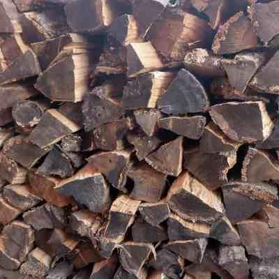savingmoneyburningwoodwoodpile