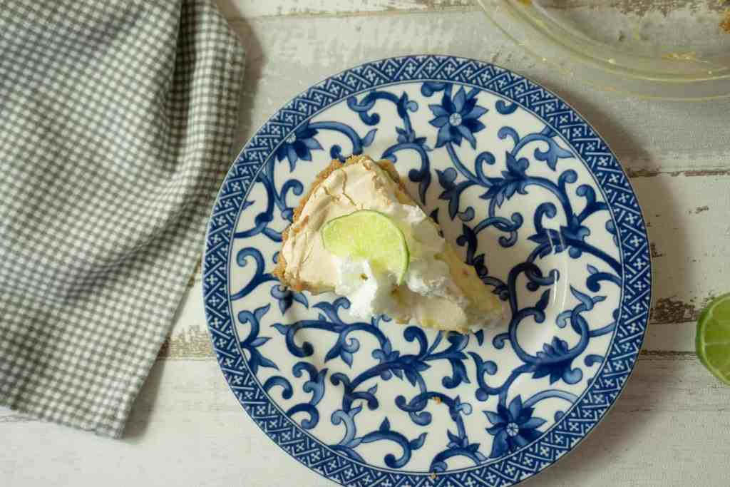 slice of key lime pie with whipped cream and fresh lime slice