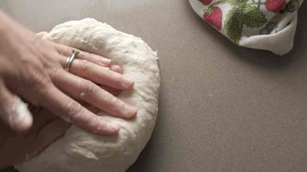 kneading sourdough rolls