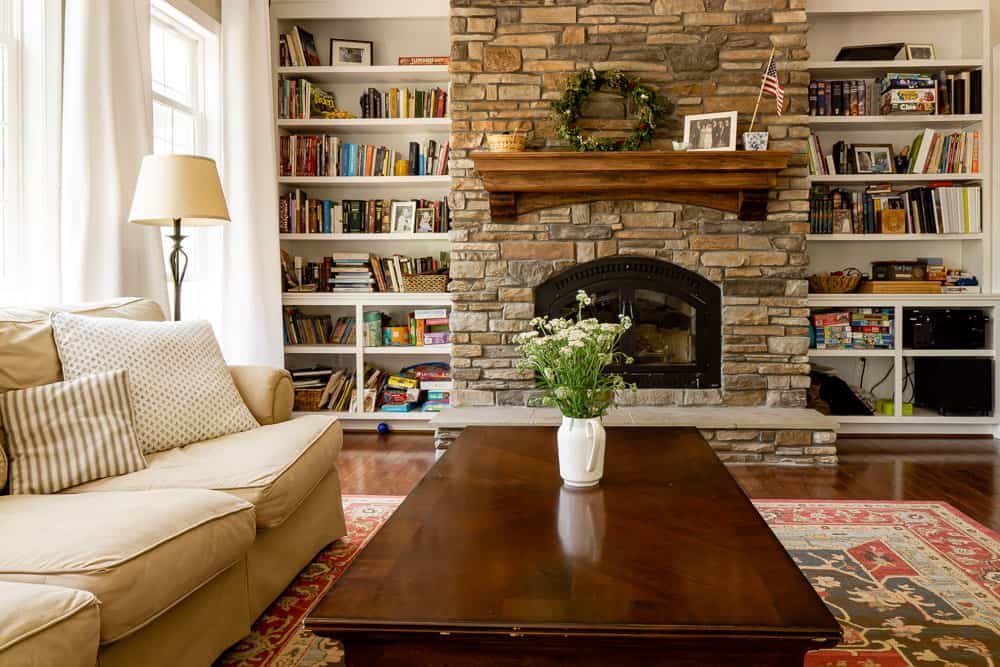 living room with shelves that are decorated over time