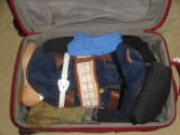 I wrapped my belts around the small duffel (which is filled with underwear, socks, tights, and camisoles) to compress it and fit more clothes into the suitcase.