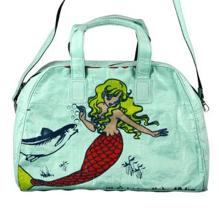 Green Mermaid Weekender bag that gives back Nomi HeartStories