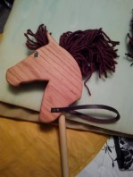 oak stick horse with brown yarn mane