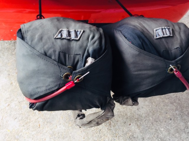 Chute bags on the back of a car.