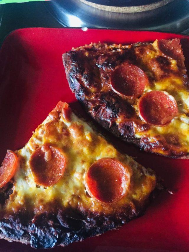 Burned slices of RealGood Cauliflower pizza