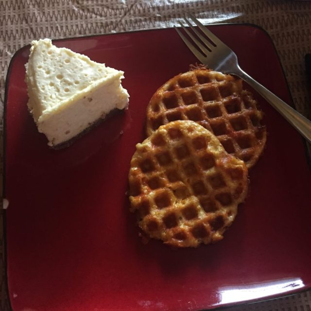 Cheesecake with chaffles on a red plate