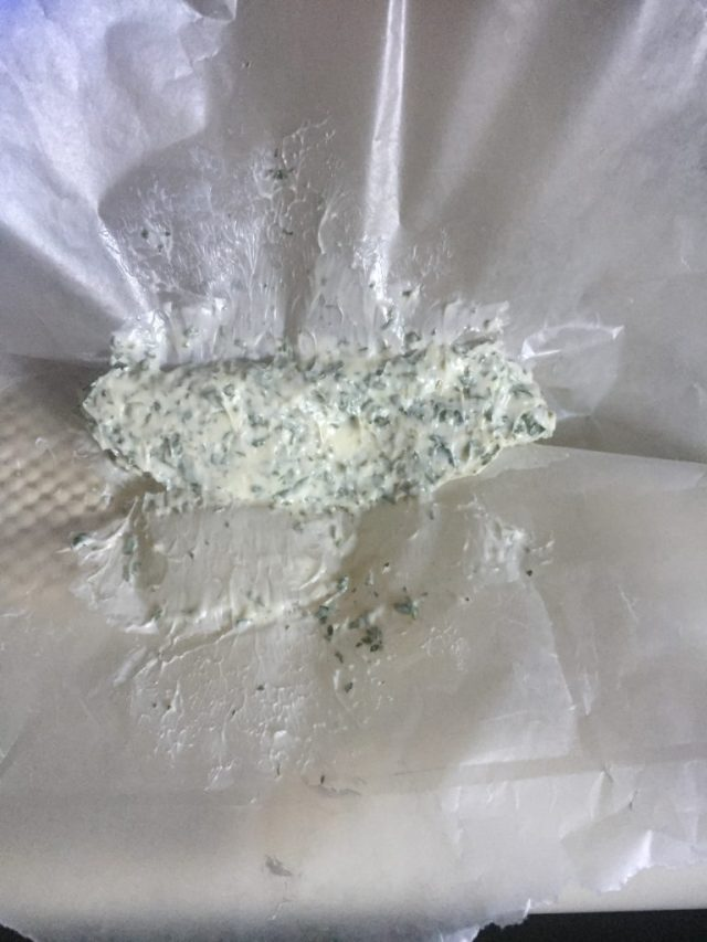 Rolling the compound butter into a log