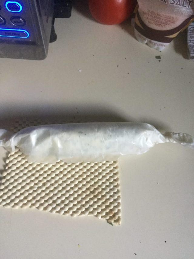 Rolled up butter in waxed paper