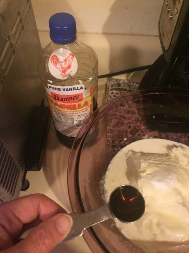 Pouring vanilla into mixing bowl