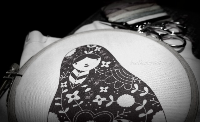 matryoshka embroidery in progress. black and white photo