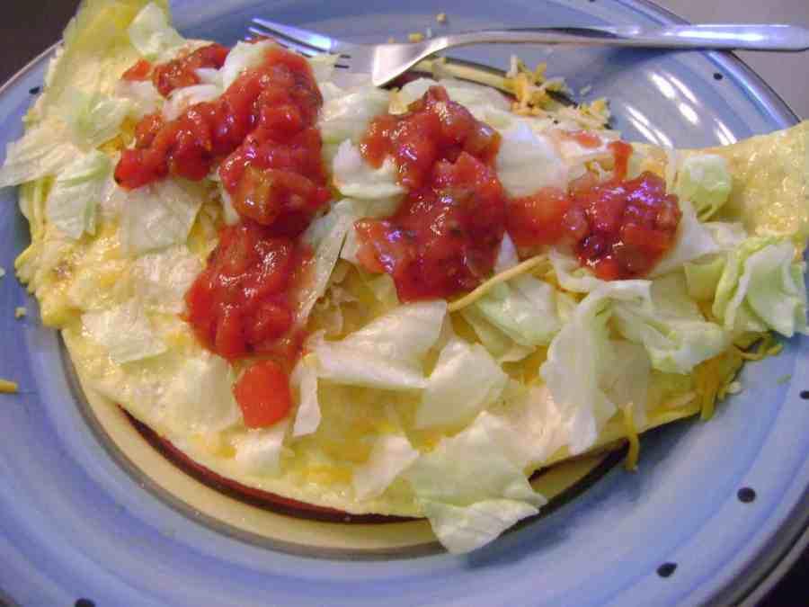 Enchilada omelet on a plate.