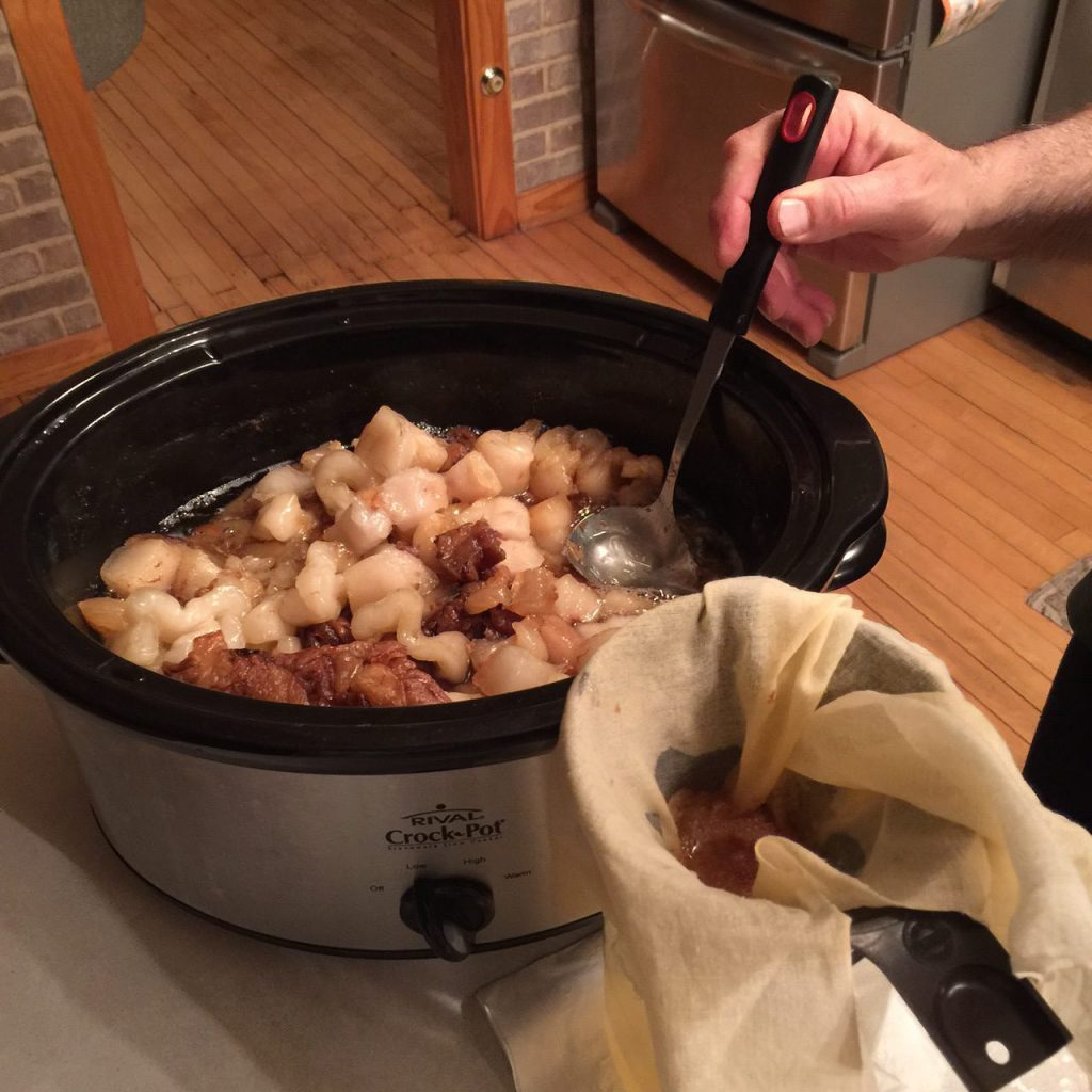 scooping lard out of the crockpot