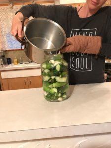 pouring brine into jar