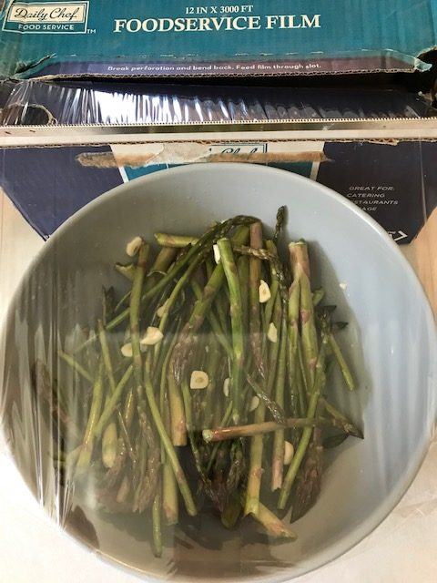 covering the asparagus mixture to put in the fridge.