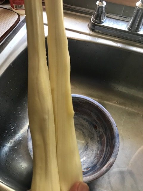 stretching the mozzarella cheese