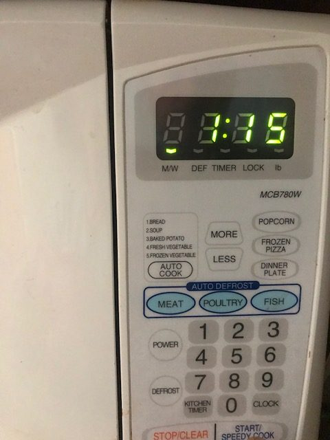 setting your timer to heat the cheese