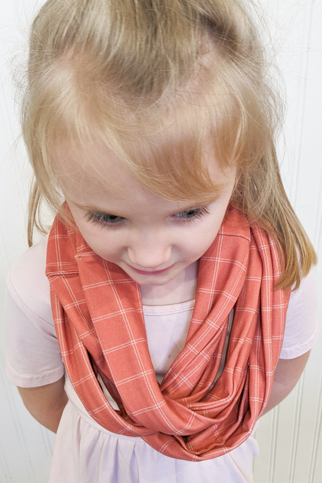 little girl wearing infinity scarf