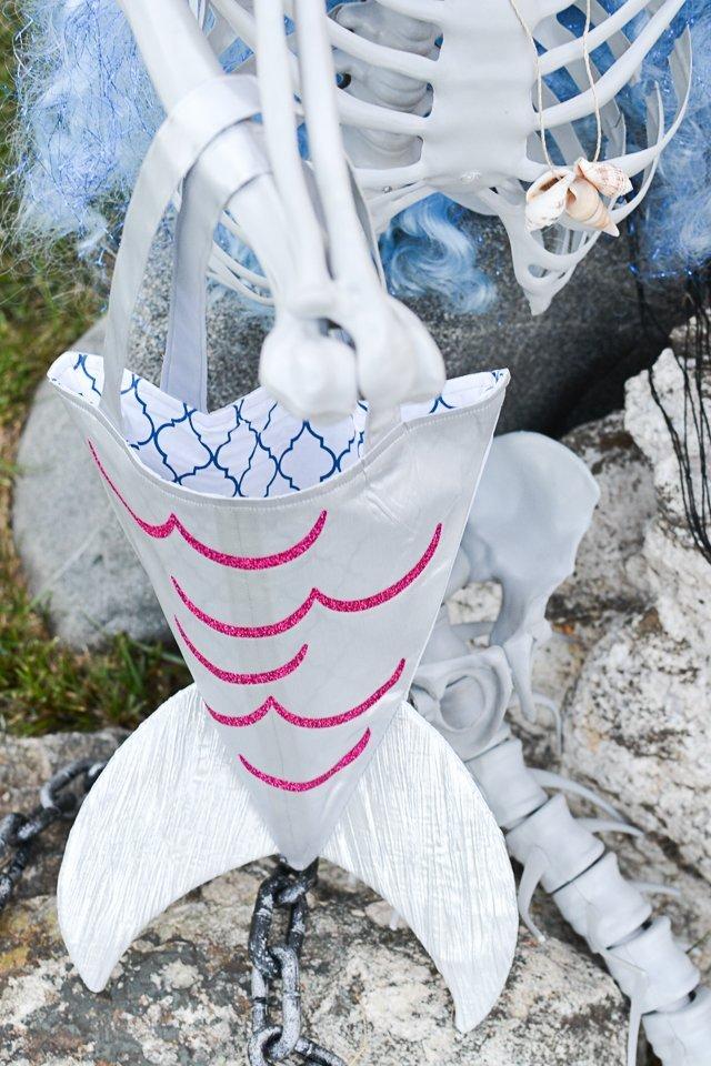 holding mermaid tote bag