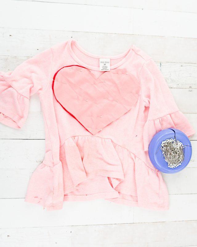 pin hearts onto shirt