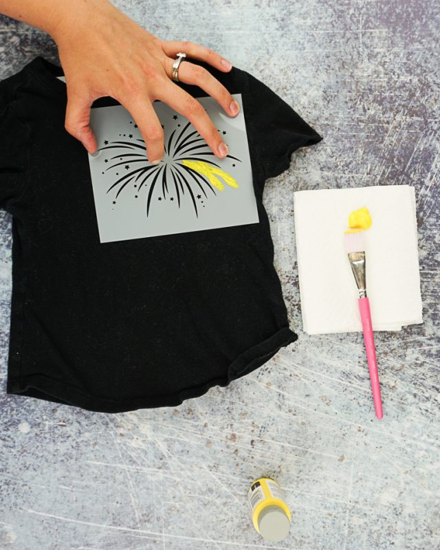 place stencil on t-shirt start painting