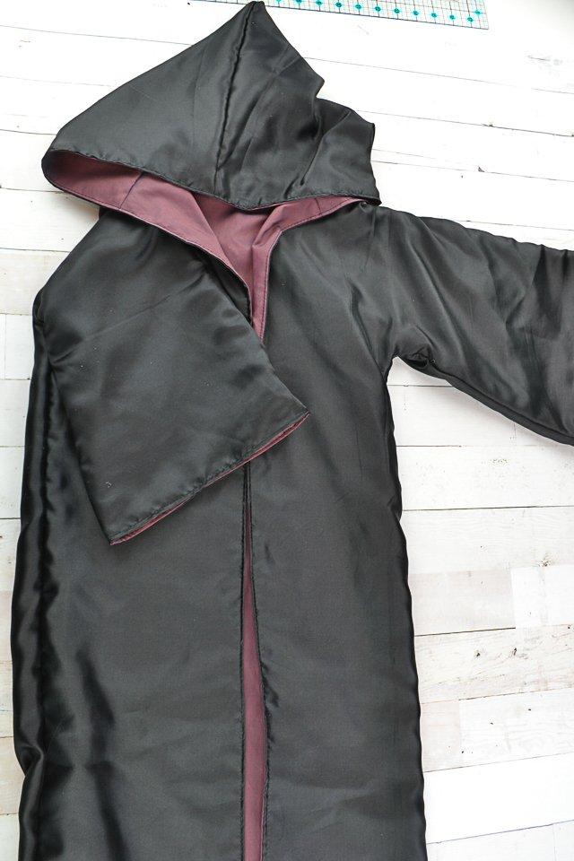 sew the hole closed on the black cloak