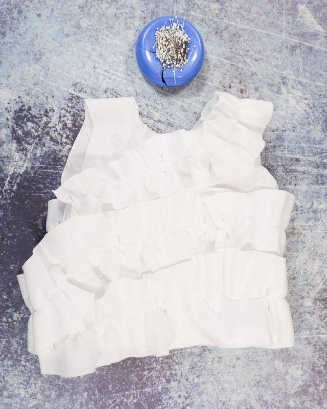 sew gathered strips onto the frosting tank top