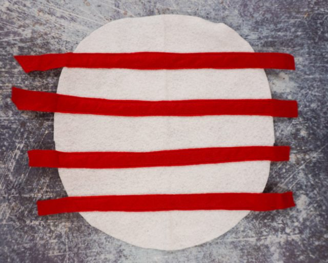 sew red strips to white circle