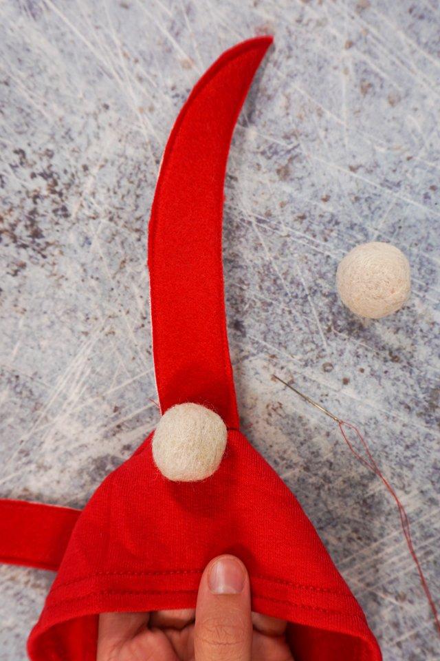 sew white felt balls at base of antennae