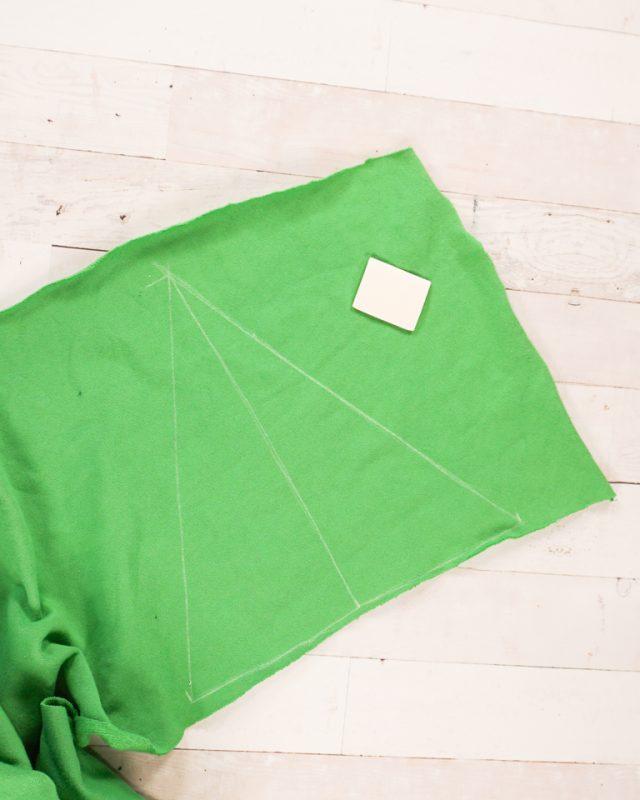 draw triangle on green fabric
