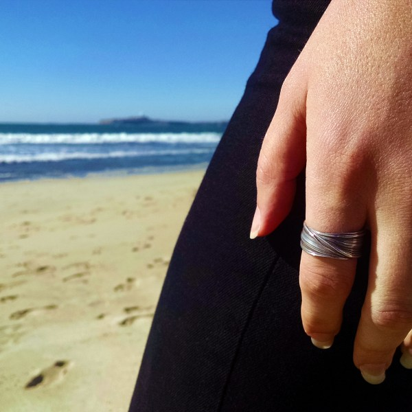 mitsuro embrace ring on hand at the beach