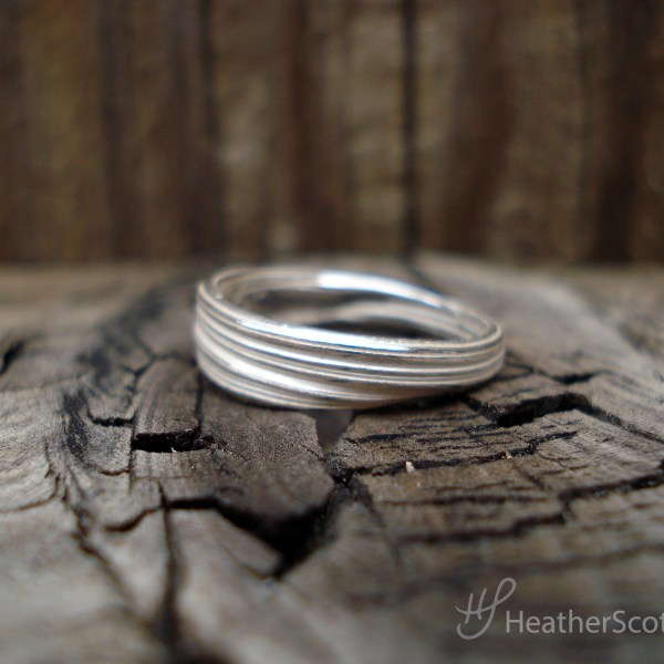 silver mitsuro ring side view