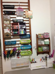 I up cycle a lot of things, I used the crib rails and Just keep adding to them, I've done thrift shopping to find fun cubbies. The dollar store rocks....Shower curtain hooks for the scissors. 12 for a buck! Can't beat that.