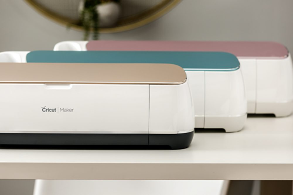a line up of Cricut Maker in three different colors