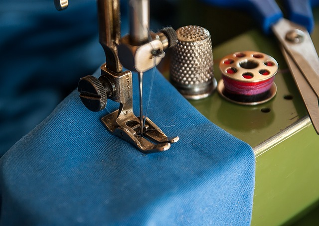 blue fabric on sewing machine