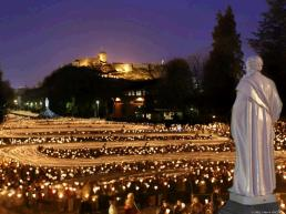 A river of candles in the nightly procession in Lourdes