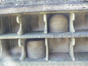 baskets in bee wall