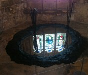 Stained glass window afloat in a sculpture called Untouched by Angus Fairhurst