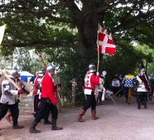 medieval soldiers leaving the field