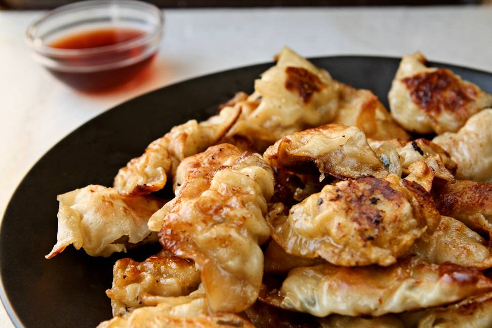 Chinese Potstickers. Easy Chinese pork dumplings to make at home. Restaurant taste and quality made with love at home. | www.heavenlyhomecooking.com