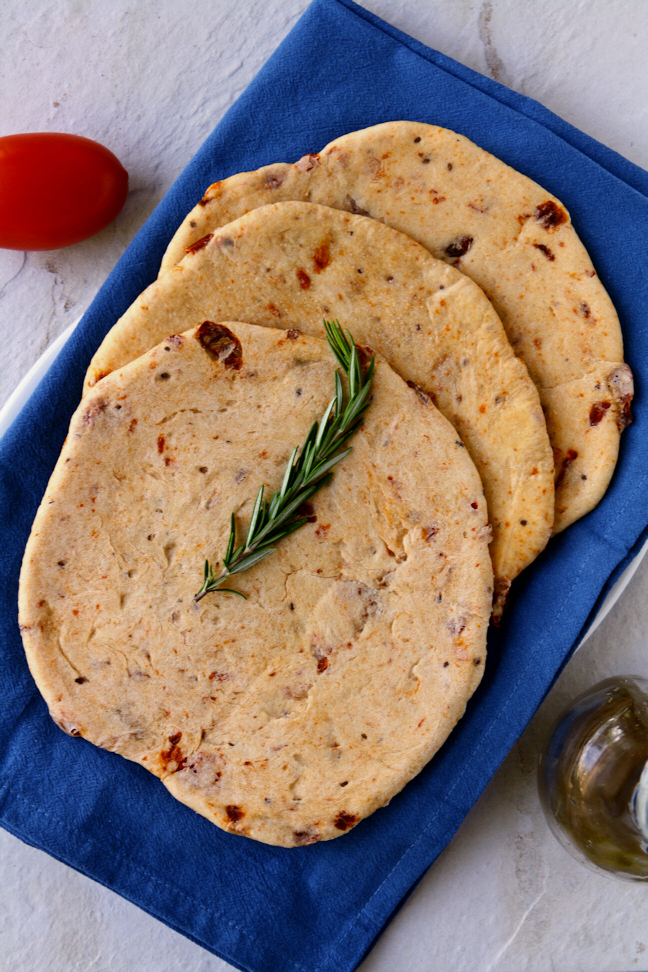 Sun-Dried Tomato Pita Bread to complement your favorite gyro fillings perfectly. Easy to make with only 7 ingredients, most of which you probably already have in your pantry.   www.heavenlyhomecooking.com